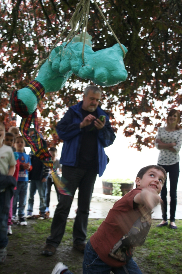 Joshua whacks the Loch Ness Monster piñata