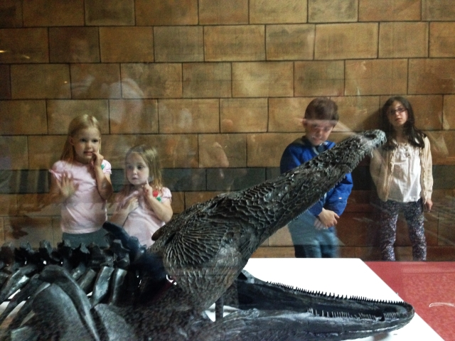 The kids enthralled by some kind of prehistoric alligator. Who wouldn't be?!